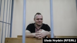 Dzmitry Halko came to the courtroom wearing a black short-sleeve shirt adorned with traditional Belarusian-Ukrainian embroidery patterns.