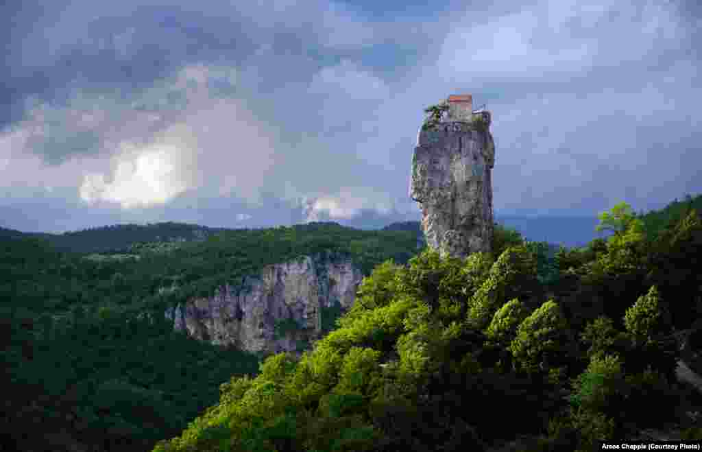 The pillar at the end of a stormy day in the valley. For centuries the 40-meter high pillar was abandoned. In 1944 a group led by the mountaineer Alexander Japaridze made the first documented ascent of the pillar and discovered the remains of a chapel and the skeleton of a stylite.