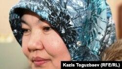 Рита Абишева, жена узбекского беженца-мусульманина Шухрата Холбаева. Алматы, 13 декабря 2010 года.