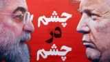 """A front page image of Iranian daily newspaper Sazandegi with Iranian president Hassan Rouhani and U.S. President Donald Trump with a title reading """"Eye to Eye"""", is laid down at a kiosk in Tehran, April 9, 2019"""