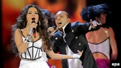 Azerbaijan's entry, AySel and Arash, sing during the song contest in Moscow in May