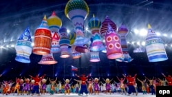 Dancers perform amid a balloon display representing Moscow's St. Basil's Cathedral during the opening ceremony for the Sochi Winter Olympics on February 7.