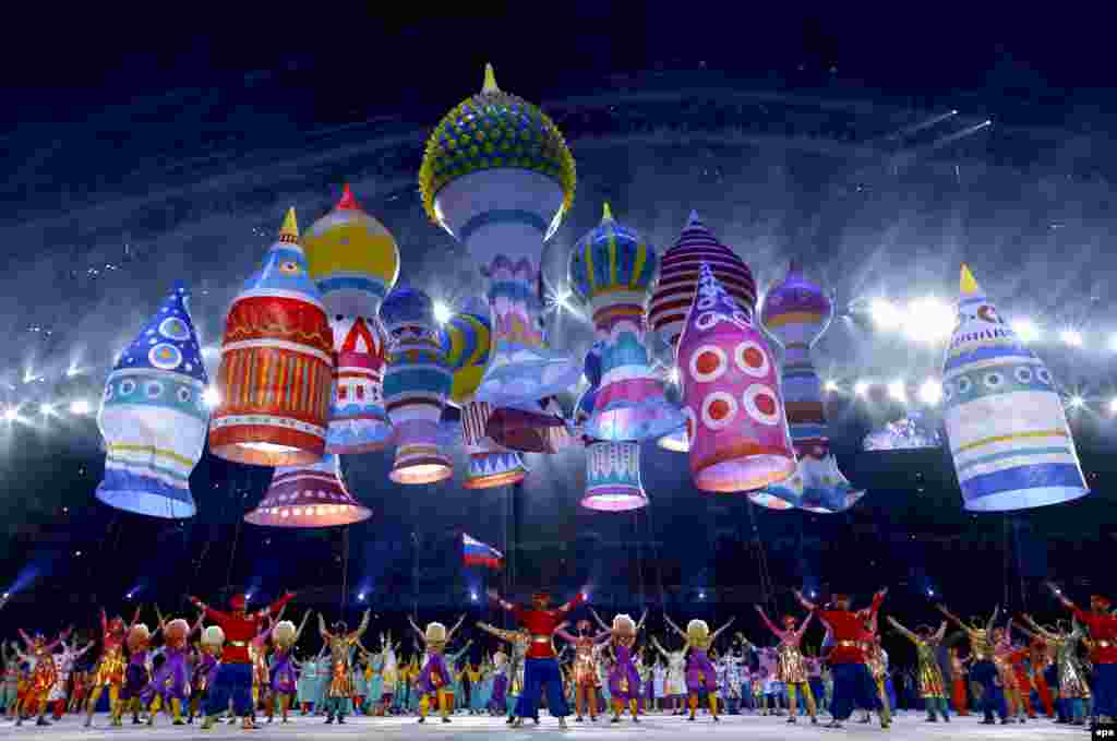 Dancers perform amid a spectacular balloon display representing Moscow's St. Basil's cathedral.