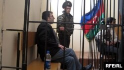 Police officer Emin Ahmadbayov on trial in a Baku court in February.