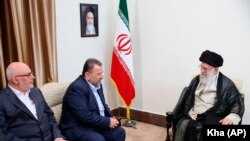 Iranian Supreme Leader Ayatollah Ali Khamenei, right, meets Hamas deputy chief, Saleh al-Arouri, second right, and the Hamas delegation, in Tehran, July 22, 2019. FILE PHOTO