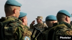 Armenia - General Yuri Khachaturov, chief of the Armenian army's General Staff, salutes troops from CSTO member states holding exercises at Marshal Bagramian shooting range, 30Sep2015.
