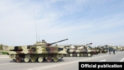 Azerbaijan - Russian-made tanks, artillery systems and attack helicopters put on display at a military base in Nakhichevan, 7Apr2014.