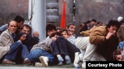Residents of Sarajevo duck sniper fire during the spring of 1992