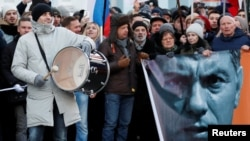 People take part in a rally to mark the anniversary of Russian opposition politician Boris Nemtsov's murder in Moscow on February 29.