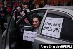 "The sign on the car says: ""Deny Serzh by honking your horn."""