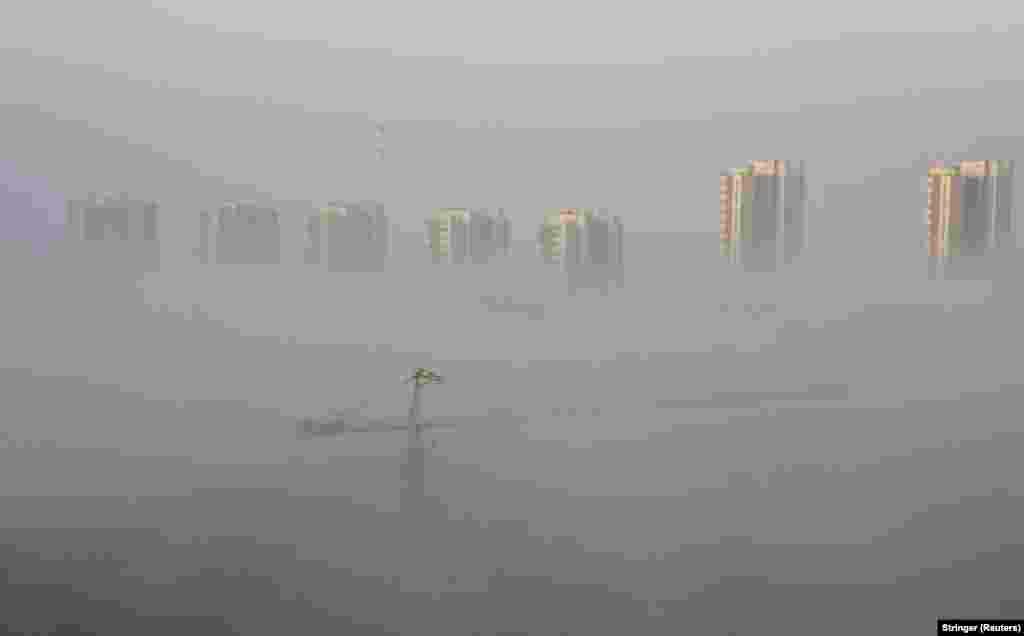 Heavy fog shrouds a construction site near a residential compound in the Chinese city of Shenyang on April 2.