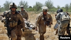 U.S. Marines carry a wounded comrade to a waiting medevac helicopter near the town of Marjah in Helmand Province.