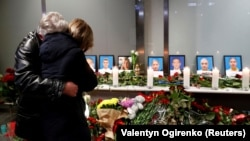 Relatives of the flight crew of the Ukrainian airliner mourn at Boryspil International Airport outside Kyiv.