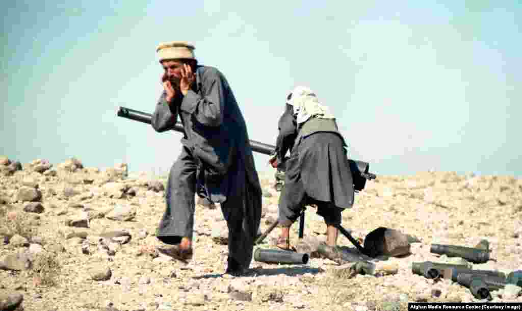 Mujahedin fighters firing a recoilless rifle. A U.S. official recalled that the CIA bought such weapons from various sources, including a corrupt unit of the Soviet Army in Afghanistan.