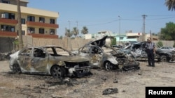 The site of a recent car bomb attack in Baghdad's Kadhimiya district