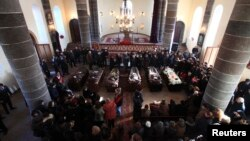 Armenia -- People surround coffins with the bodies of six murdered members of the Avetisian family during a funeral ceremony in Gyumri, January 15, 2015