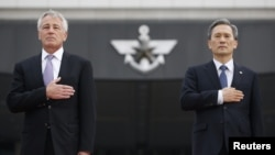 U.S. Secretary of Defense Chuck Hagel (left) and South Korean Defense Minister Kim Kwan-jin in Seoul on October 2
