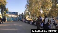 People wait in a long line to vote in parliamentary elections in Kandahar on October 27.