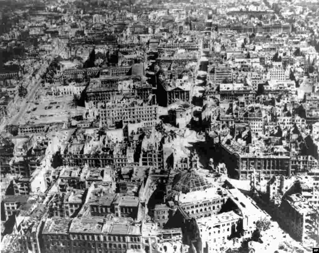 "An overview of central Berlin shot from an American plane shortly after the Allied victory in Europe.   Germans referred to the stillness that followed the raging battles for Berlin as ""Stunde Null"" (Hour Zero), the moment of ""an absolute break with the past and a radical new beginning."""