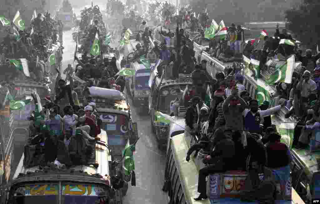 "Supporters of religious leader Tahir-ul Qadri gather in Lahore on January 13 to take part in the ""Caravan of Democracy March."""