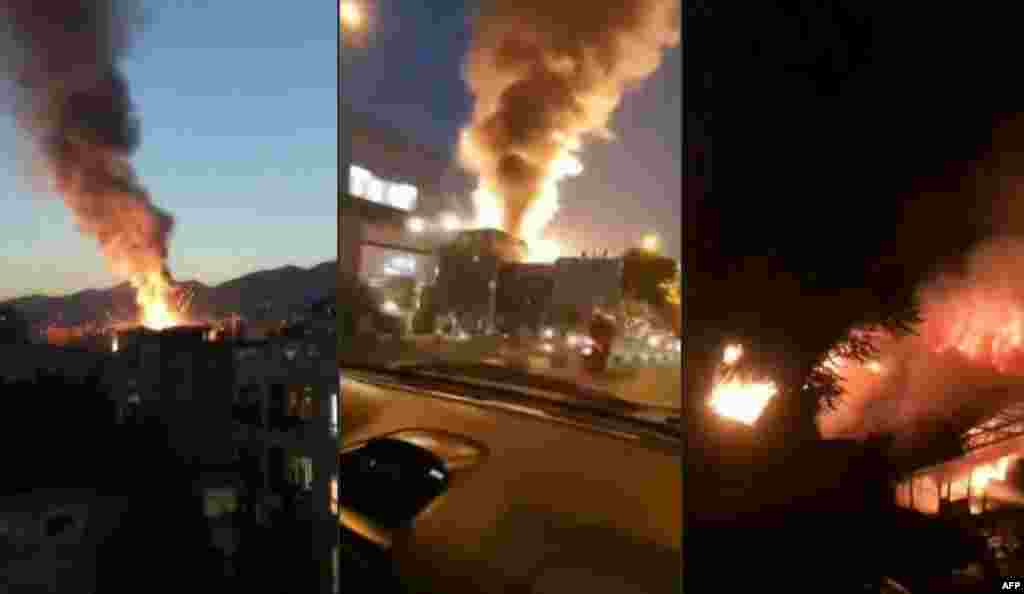 This combination image shows stills from footage obtained from the state-run Iran Press news agency of the fire and smoke following the powerful explosion.
