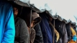 "BOSNIA-HERZEGOVINA -- Illegal migrants line-up for lunch distribution at the ""Vucjak"" camp, on the outskirt of the city of Bihac, November 19, 2019"