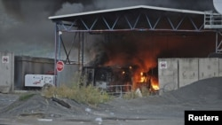 Kosovo -- The Serbia-Kosovo border crossing burns after masked Serb extremists set it on fire, Jarinje, 27Jul2011