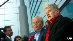Lon Snowden (right) speaking to journalists after his October 10 arrival in Moscow