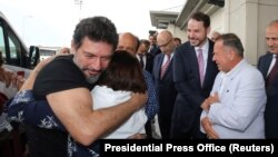 TURKEY -- Mehmet Hakan Atilla, an executive from state-controlled Halkbank, is welcomed by his relatives and Turkish Treasury and Finance Minister Berat Albayrak as he arrives at Istanbul International Airport in Istanbul, July 24, 2019