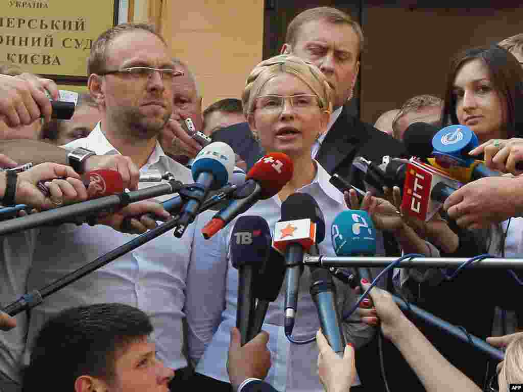 Tymoshenko talks to the press shortly before her arrest in Kyiv on August 5, 2011.