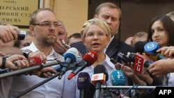 Yulia Tymoshenko talks to the press in front of the court in Kyiv before her arrest.