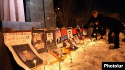 Pictures of opposition supporters killed in Yerevan in March 2008 are placed at the site of the deadly postelection unrest in March 2012. Opposition parties will watch for a clean vote.