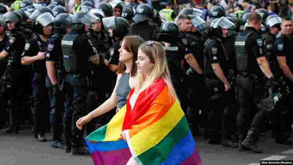 Ukrainian police guard participants of the Equality March organized by the LGBT community in Kyiv on June 23, 2019.