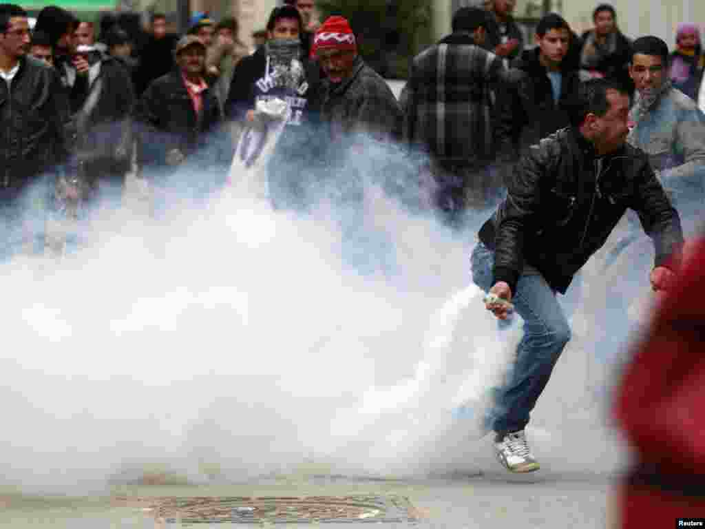 A protester throws a tear-gas canister back at riot police during a demonstration in Tunis on January 18, shortly after protests forced out longtime President Zine El Abidine Ben Ali in the first wave of the uprisings known as the Arab Spring. (Reuters/Zo