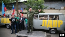 Liberal Democratic Party of Russia leader Vladimir Zhirinovsky, dressed as a Russian paratrooper, speaks in Moscow before sending humanitarian aid from his party to pro-Russian separatists in Luhansk and Donetsk in eastern Ukraine in June.