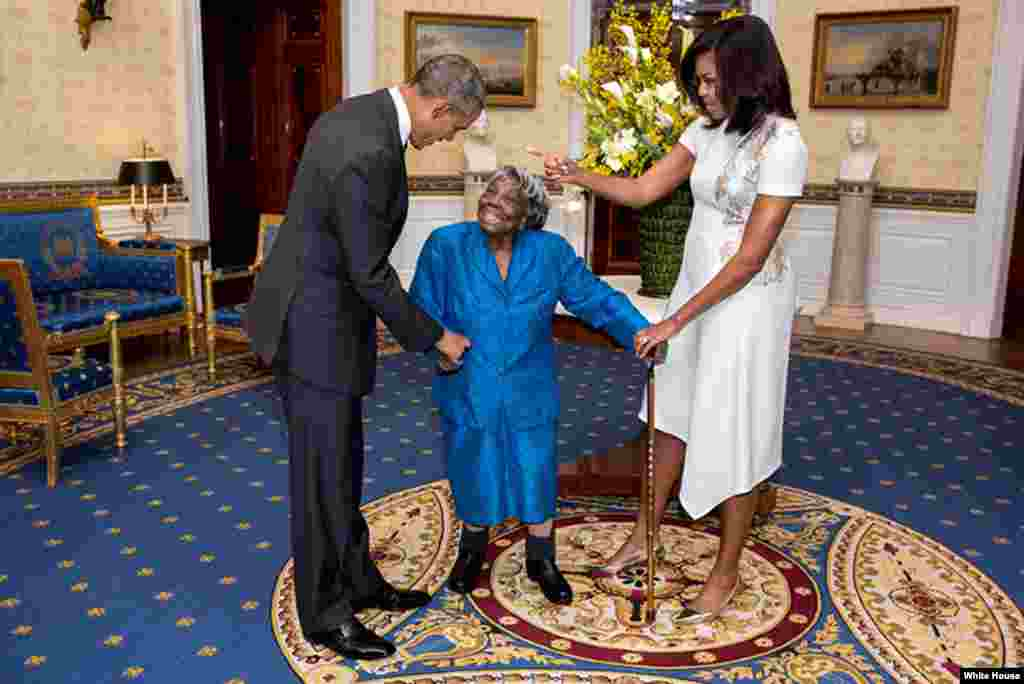 Michelle and Barack Obama dance with 106-year-old Virginia McLaurin at the White House ahead of a reception celebrating African American History Month on February 18, 2016.