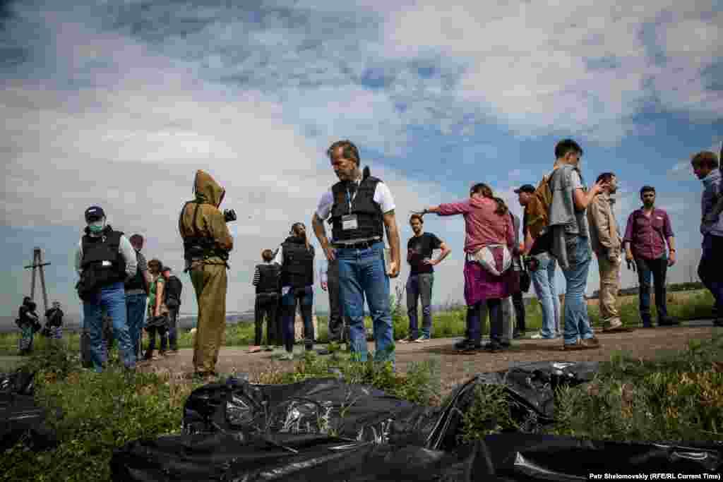OSCE monitors visit the crash site.