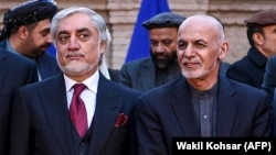 Afghan President Ashraf Ghani (right) and his political rival, Abdullah Abdullah, seem to have resolved a longstanding dispute.