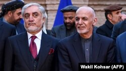 FILE: Abdullah Abdullah and Afghan President Ashraf Ghani (R) during an event in Kabul on February 29.