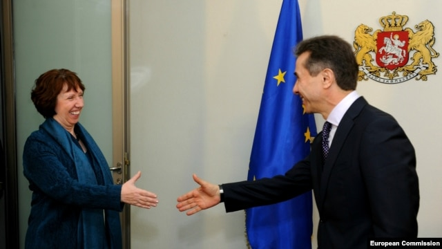 "Georgian Prime Minister Bidzina Ivanishvili meets with EU foreign-policy chief Catherine Ashton in Tbilisi on November 26. ""Investigations into past wrongdoings must be -- and must be seen to be -- impartial, transparent, and in compliance with due process,"" Ashton said."
