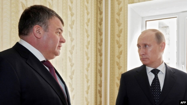 Then-Defense Minister Anatoly Serdyukov (left) with Prime Minister Vladimir Putin in the city of Engels in April, seven months before Serdyukov was sacked.
