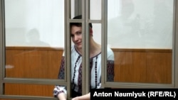 Ukrainian pilot Nadezhda Savchenko follows trial proceedings in a Russian court earlier this month.