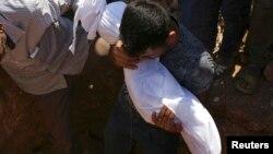 Похороны Айлана Курди в сентябре прошлого года