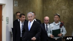 File photo:Israeli Prime Minister Benjamin Netanyahu (C) arrives at a weekly cabinet meeting in Jerusalem on June 2, 2019.