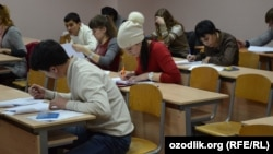 Russia/Uzbekistan - migrants pass an exam from Russian history, language and legislation of the Russian Federation in school educational training of migrants at People's Friendship University of Russia