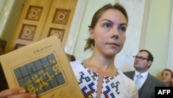 Vira Savchenko holds a book written in prison by her sister Nadia during its presentation at the Ukrainian parliament in Kyiv earlier this year.