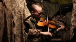 'Music Takes Your Mind Off War And Death': Ukrainian Violinist Plays In The Trenches