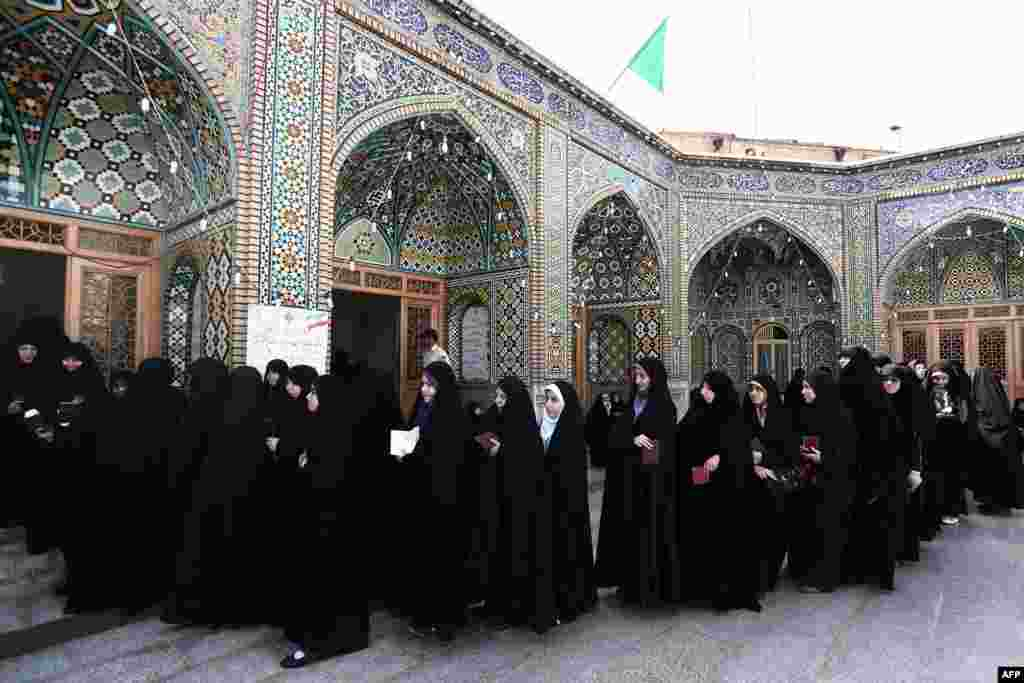 Women wait to vote at a polling station at the Massoumeh shrine in the holy city of Qom.