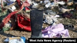 Passengers' belongings are pictured at the site where the Ukraine International Airlines plane crashed after take-off from Iran's Imam Khomeini airport, on the outskirts of Tehran, January 8, 2020