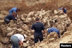A mass grave of some of the victims of the Srebrenica genocide being uncovered in 1996.